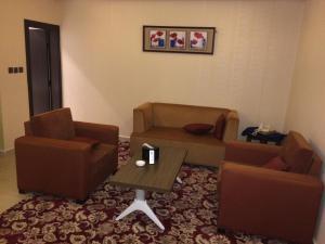 Uma área de estar em Zievle Executive Apartments