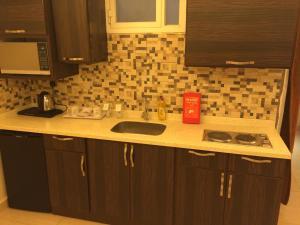 A cozinha ou cozinha compacta de Zievle Executive Apartments