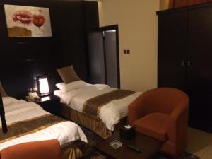 Cama ou camas em um quarto em Zievle Executive Apartments