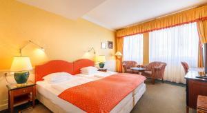 Postel nebo postele na pokoji v ubytování Dvorak Spa & Wellness