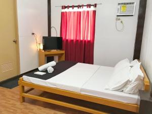 A bed or beds in a room at DGA Coron Accommodation