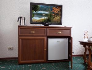Телевизор и/или развлекательный центр в Гостиница Тула