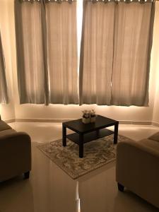 Uma área de estar em Al Taif Villas
