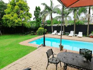 The swimming pool at or close to Hillton Manor Guest House