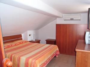 A bed or beds in a room at Villino Rosalia