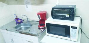 A kitchen or kitchenette at Hotel Sakoda