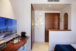 TV o dispositivi per l'intrattenimento presso Portixol Hotel & Restaurant