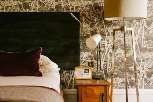 A bed or beds in a room at Jesmond Dene House