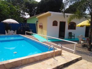 The swimming pool at or near Hospedaria Ilha de Paqueta