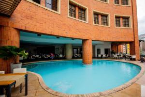 The swimming pool at or near Hotel Dann Cali