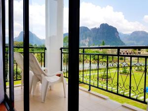 A balcony or terrace at Simon Riverside Hotel