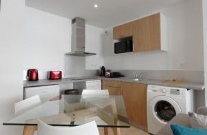 A kitchen or kitchenette at ROYAL CASTEL