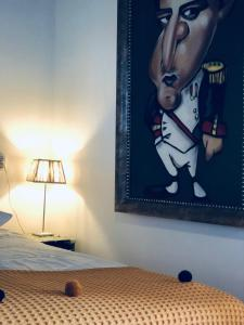 Een bed of bedden in een kamer bij B&B KADUSHI