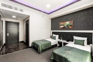 Cama ou camas em um quarto em ISMAYILLI RESORT HOTEL