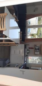 Cuisine ou kitchenette dans l'établissement Domaine