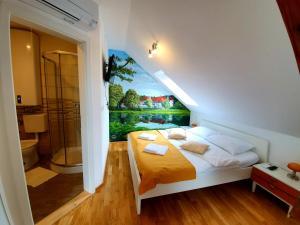 Cama o camas de una habitación en B&B Vila Teslova