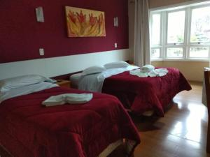 A bed or beds in a room at Pousada Ruppenthal