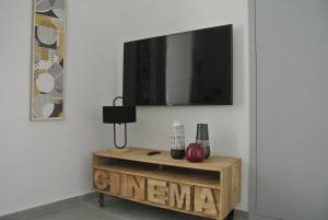 A television and/or entertainment centre at Urban Luxury Apartment Salerno