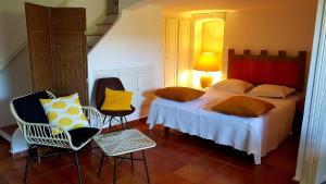 Un ou plusieurs lits dans un hébergement de l'établissement Clos des Vignes Pampelonne Vineyard
