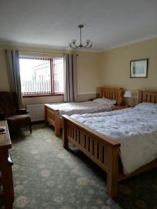 A bed or beds in a room at Hillview Park