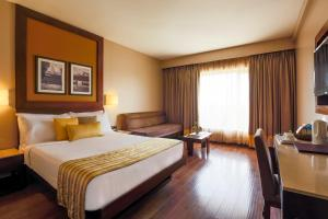 A bed or beds in a room at Sun-n-Sand Shirdi