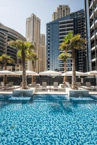 The swimming pool at or near Fantastay Sparkle Tower One Bedroom Suite Marina view
