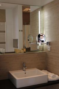Ein Badezimmer in der Unterkunft Heiner's Parkhotel