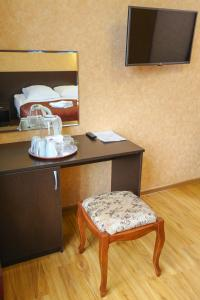 A television and/or entertainment center at Hotel Kavkaz