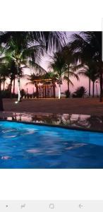The swimming pool at or near Pousada Recanto da Praia