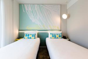 A bed or beds in a room at ibis Styles East Perth