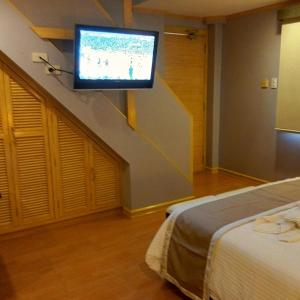 A television and/or entertainment centre at Shore Time Hotel Boracay