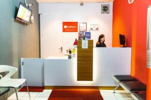 The lobby or reception area at RedDoorz Apartment @ Bogor Valley