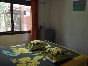 Cama ou camas em um quarto em Les Manguiers