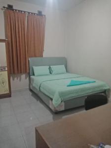Ein Sitzbereich in der Unterkunft Suite Pakar Hotel