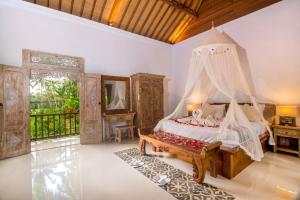 Ein Bett oder Betten in einem Zimmer der Unterkunft Alam Dania Cottage