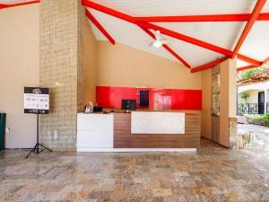 O saguão ou recepção de OYO Kalamari Beach Hotel
