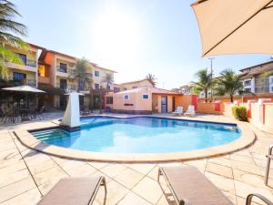 A piscina localizada em OYO Kalamari Beach Hotel ou nos arredores