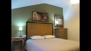 Cama o camas de una habitación en Apartamentos Alcazar de Baeza