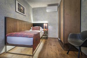 A bed or beds in a room at Hotel Waldstein