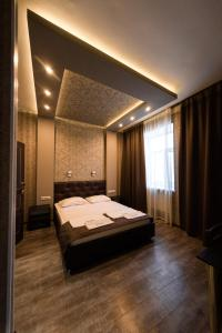 Кровать или кровати в номере Belvedere