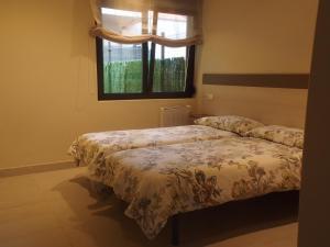 Cama o camas de una habitación en Apartamentos Borizu Playa