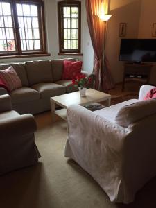 Ein Sitzbereich in der Unterkunft Villa Tadina Ferienwohnungen Mariazell
