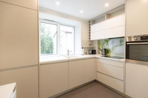 Virtuve vai virtuves zona naktsmītnē City center Gauja apartment