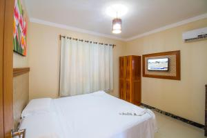Cama ou camas em um quarto em Vila Miola Hotel