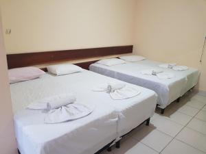 A bed or beds in a room at Hotel Legal
