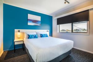 A bed or beds in a room at Nightcap at Riverside Hotel