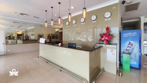 The lobby or reception area at SCC Hotel
