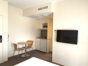 A television and/or entertainment center at Airport Ascot Motel