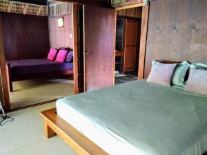 Cama ou camas em um quarto em Pool Mountain Moorea