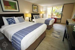 A bed or beds in a room at Banyan Hotel & MicroSuites